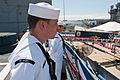 US Navy 110421-N-BT887-090 Operations Specialist Seaman Michael Graves stands at parade rest during the decommissioning ceremony of the guided-miss.jpg