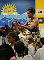 US Navy 110721-N-IE405-129 First Lady Michelle Obama dances with children of service members at the Naval Air Station Oceana Child and Youth Progra.jpg