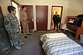US Navy 110811-N-ZS587-009 Lt. Andrew Takach, left, gives Army Cpl. Jeremey Kuehl, right, and Army Staff Sgt. Loriann DeMelis a tour of the new Wou.jpg