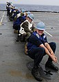 US Navy 111003-N-WJ771-152 ailors and Marines assigned to the forward-deployed amphibious transport dock ship USS Denver (LPD 9) heave around on a.jpg