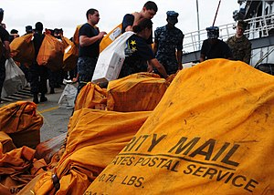 US Navy 111212-N-FH966-163 Sailors and Marines move mail.jpg