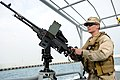 US Navy 120107-N-RP435-709 Gunner's Mate 3rd Class Matthew Woods mans a .50-caliber machine gun aboard a U.S. Navy coastal patrol boat during a pat.jpg