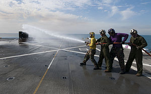 US Navy 120126-N-PB383-291 Sailors and Marines fight a simulated fire during a firefighting drill on the flight deck of the amphibious transport do.jpg
