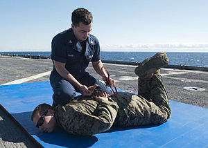 US Navy 120201-N-NR955-057 Logistics Specialist 3rd Class Anthony W. Harb cuffs Lance Cpl. Karl J. Leitz, a military policeman assigned to Combat L.jpg