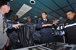 US Navy 120202-N-IZ292-146 Sailors from the guided-missile frigate USS Simpson (FFG 56) receive a brief from Royal Moroccan Navy Ensign Nabil Elkor.jpg