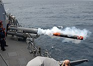 US Navy 080221-N-7446H-016 Weapons department personnel launch an inactive torpedo off the port side of the Arleigh Burke-class guided-missile destroyer USS Mustin (DDG 89)
