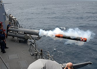 USS Mustin launches a dummy torpedo during exercises. US Navy inactive torpedo launch.jpg