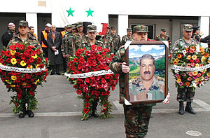 Early insurgency phase of the Syrian Civil War - The funeral procession of Syrian General Mohammed al-Awwad who was assassinated in Damascus in January 2012