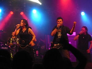 """Van Canto - van Canto performing at the 2008 Wacken Open Air. From left to right: Inga, Dennis and Stefan. Partially seen behind Inga are drummer Bastian and former """"bass"""" vocalist Ingo. Ross is not shown."""
