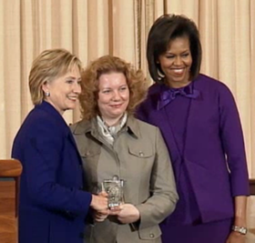Veronika Marchenko (Russia) with Secretary of State Hillary Rodham Clinton and First Lady Michelle Obama.png