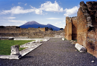 Mount Vesuvius - Mount Vesuvius as seen from the ruins of Pompeii, which was destroyed in the eruption of AD 79. The active cone is the high peak on the left side; the smaller one on the right is part of the Somma caldera wall.