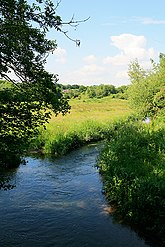 Upstream of River Meon as it crosses Ironmill Lane, Fareham, north of the M27 motorway