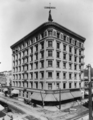 W. E. Cummings store in Grant Block, NW corner 4th and Broadway, shortly after Grant Building was enlarged to 7 stories in 1902.png