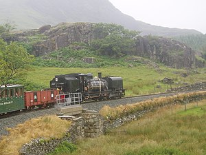 Welsh Highland Railway restoration - SAR NGG 16 Class Garratt Locomotive No. 143 in the countryside