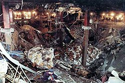 Pit of devastation with steel columns rising from the bottom