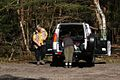 Walkers Returning To Land Rover. Chobham Surrey UK.jpg