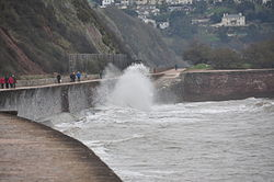 Waves breaking on the sea wall at Teignmouth (0119).jpg