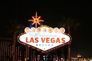 Welcome to Fabulous Las Vegas sign - The sign at night with the lights illuminated.