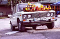 White Lada 2106 with milk and honey on its hood.jpg
