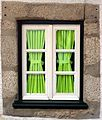 Window and green curtain (3804634922).jpg