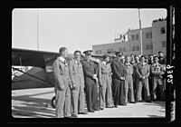 Wings over Palestine-Certificates of Flying School, April 21, 1939. Young pilots who received their flying licenses with instructors (Lydda Air Port) LOC matpc.18306.jpg