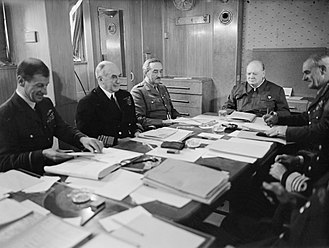 Charles Portal, 1st Viscount Portal of Hungerford - Seated in May 1943 around a conference table aboard the SS QUEEN MARY are, left to right: Air Marshal Sir Charles Portal, Admiral of the Fleet Sir Dudley Pound, General Sir Alan Brooke, Mr Winston Churchill. Prime Minister Churchill is presiding over the meeting at the end of the table.