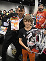 Wizard World Anaheim 2011 - kids really do win TIE Fighters from artist Luis Calderon! (5675034286).jpg