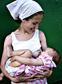 Woman breastfeeding an infant.jpg