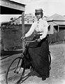 Woman cycling in Brisbane, ca.1900 (26871293536).jpg