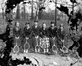 Wooded lot, girls tennis, probably Peace College, Raleigh, NC, c.1900-1910's. Original glass plate negative is from the J. C. Knowles Collection, PhC.182, State Archives of North Carolina. (8720624685).jpg
