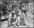 """Marine Sgt. F. Smit...and Cpl. S. Brown...open a coconut to get a cool drink on Saipan."", 06-1944 - NARA - 532391.jpg"