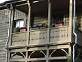 Цветы на балконе двухэтажного деревянного жилого дома. Flowers on a balcony of a wooden two-storey living house.jpg