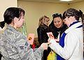 100th woman arriving on Transit Center receives mink coat DVIDS258115.jpg