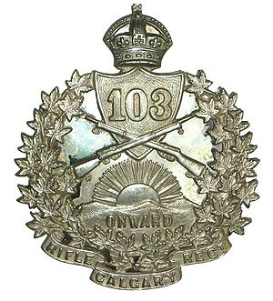 "103rd Regiment (Calgary Rifles) - 103rd Calgary Rifles cross-belt badge.  Two part, sterling silver badge consisting of a cast front badge and a rear plate with maker's mark, ""JR Gaunt Montreal"".  Badge was affixed to the cross-belt with four screw-down lugs."