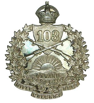 """103rd Regiment (Calgary Rifles) - 103rd Calgary Rifles cross-belt badge.  Two part, sterling silver badge consisting of a cast front badge and a rear plate with maker's mark, """"JR Gaunt Montreal"""".  Badge was affixed to the cross-belt with four screw-down lugs."""