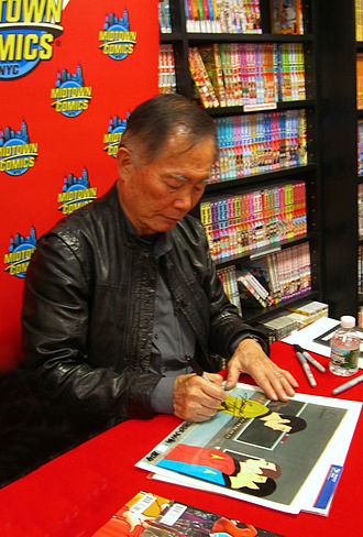 Star Trek: The Animated Series - Actor George Takei autographing an original animation cel from the series at Midtown Comics in Manhattan.