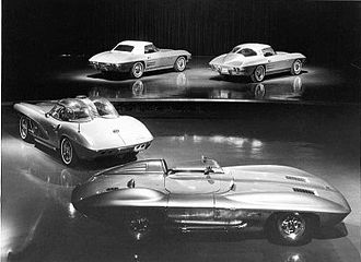 Chevrolet Corvette (C2) - The 1959 Corvette Sting Ray concept and 1960 XP-700 show car in the front and the 1963 Corvette convertible and fastback in the back.