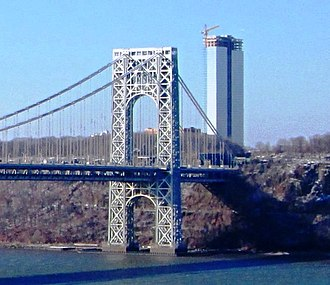 Fort Lee, New Jersey - The George Washington Bridge, connecting Fort Lee (above) in Bergen County across the Hudson River to New York City, is the world's busiest motor vehicle bridge. One of two 47-story residential skyscrapers, Bergen County's tallest, is seen under construction near the gateway to the bridge in December 2013.