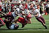2013 Louisville - Eastern Kentucky - Ryan Hubble tackled (9723266075).jpg