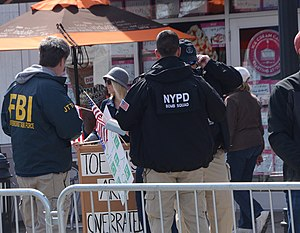 2014 Boston Marathon - Barriers, FBI Joint Terrorist Task Force, NYPD officers—three examples of increased security