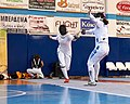 2nd Leonidas Pirgos Fencing Tournament. Flèche and touch for Irini Mavrikiou.jpg