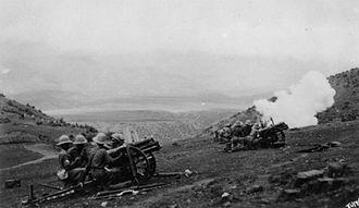 QF 3.7-inch mountain howitzer - Indian gun crew firing, India, circa. 1930