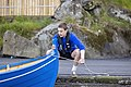 A Faroese rower and his boat. Photo by Ólavur Frederiksen, July 19, 2021.jpg