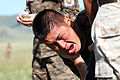 A Mongolian service member is decontaminated after running through a pepper spray qualification course during Non-Lethal Weapons Executive Seminar (NOLES) 13 at Five Hills Training Area, Mongolia, Aug. 21, 2013 130821-M-DR618-087.jpg