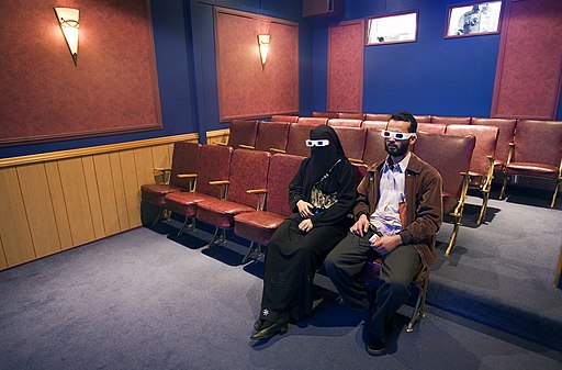 A Muslim couple sitting wearing 3D goggles, Auckland - 0740