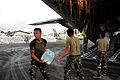 A Philippine soldier helps the crew of the first Royal Air Force C130 transport aircraft to arrive in the Philippines unload food aid and water as part of the UKs humanitarian assistance to victims of Typhoon Haiyan (10962962175).jpg
