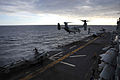 A U.S. Marine Corps MV-22B Osprey tiltrotor aircraft prepares to land on the flight deck of the amphibious assault ship USS Bataan (LHD 5) Dec. 10, 2013, in the Atlantic Ocean 131210-N-JX484-049.jpg
