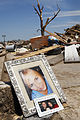 A family's photos lie among the rubble of their home in Moore, Okla., May 22, 2013, after an EF5 tornado struck the area two days earlier 130522-Z-VF620-3779.jpg