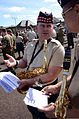 A musician with the Royal Regiment of Scotland discusses changes to the show score with U.S. Naval Forces Europe Band Musician 3rd Class Andrew Francisco, right, during a rehearsal for the Royal Edinburgh 120731-N-VT117-1079.jpg