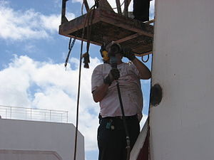 Able seaman - Dayworker AB preparing a mast for painting